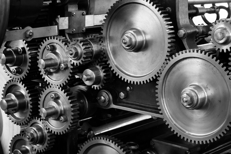 gray scale photo of gears by casting.jpg